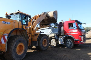 Loading Hills tipper vehicle at Shorncote Quarry inert tipping area